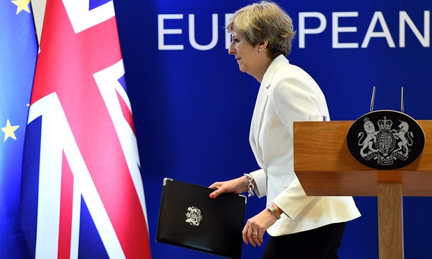 Theresa May at the end of a European Council meeting